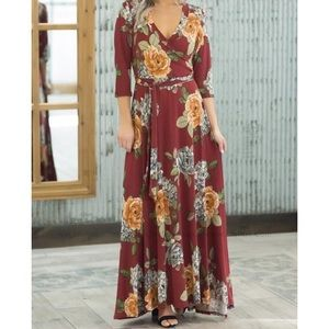 Take it all in floral wrap maxi dress in burgundy.